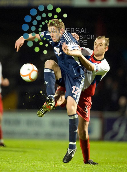 FOOTBALL.IRN BRU SFL .Ross County v Inverness CT.Ross County player Garry Wood holds off Grant Munro.Picture by Gordon Gillespie