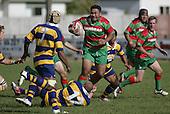 S. Kata goes over the top of B. Maloney. Counties Manukau Premier Club Rugby, Waiuku vs Patumahoe played at Rugby Park, Waiuku on the 8th of April 2006. Waiuku won 18 - 15