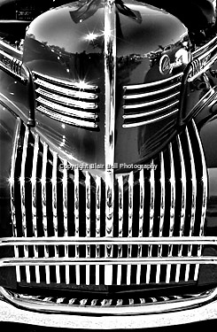 Old 1939 restored Chrysler Royal automobile, close up of the grill.