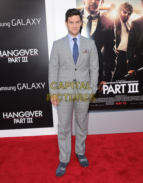 "Justin Bartha.""The Hangover Part III"" Los Angeles Premiere held at the Westwood Village Theater, Los Angeles, California, USA..May 20th, 2013.full length blue shirt tie grey gray suit  check.CAP/DVS.©DVS/Capital Pictures"