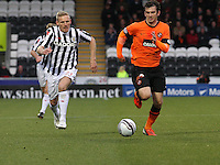 Gary Teale (left) and Gavin Gunning chase the ball in the St Mirren v Dundee United Clydesdale Bank Scottish Premier League match played at St Mirren Park, Paisley on 27.10.12.