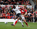 Clayton Donaldson of Sheffield Utd tackled by Joe Worrall of Nottingham Forest during the Championship match at the City Ground Stadium, Nottingham. Picture date 30th September 2017. Picture credit should read: Simon Bellis/Sportimage