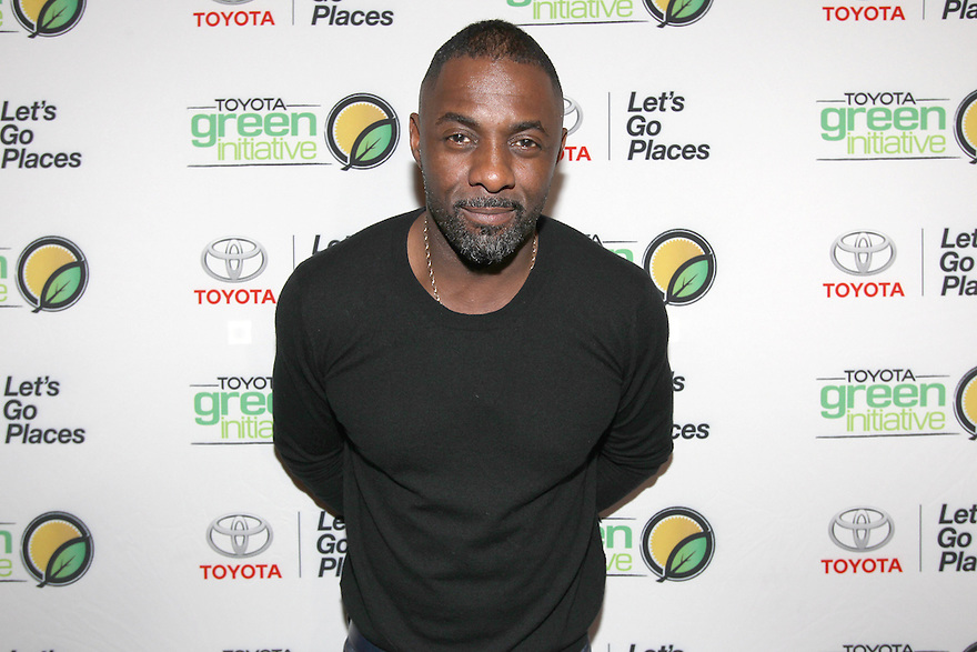 Idris Elba pose for a photo after making a surprise appearance at the Toyota SWAC 2014 Championship Game