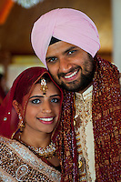 A newly wed young Indian couple during a traditional wedding celebration in an Indian Sikh temple.