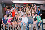 DOUBLE 18TH: Dominic Tynan, Ballymac, and Jessica Ryle, Rathoonane (seated 4th & 5th right) had a fab time celebrating their 18th birthdays with many friends and family in the Abbey Inn last Saturday night.