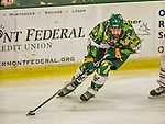 24 November 2013: University of Vermont Catamount Forward Chris McCarthy, a Senior from Collegeville, PA, in third period action against the University of Massachusetts Minutemen at Gutterson Fieldhouse in Burlington, Vermont. The Cats wore special camouflage jerseys to celebrate Military Appreciation Day. The game-worn jerseys were auctioned off with proceeds benefiting the Vermont Veterans Fund (VVF). The Catamounts shut out the Minutemen 2-0 to sweep the 2-game home-and-away weekend Hockey East Series. Mandatory Credit: Ed Wolfstein Photo *** RAW (NEF) Image File Available ***