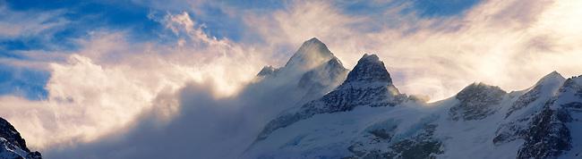 Wetterhorn Mountain in clouds at sunset. Swiss Alps, Switzerland