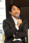 """September 29, 2017, Tokyo, Japan - Former Formula 1 driver Ukyo Katayama speaks after he drove an eleectric personal mobility """"Landboard"""" developed by Japanese automobile venture Exmachina at a press preview in Tokyo on Friday, September 29, 2017. Exmachina also displayed two-seater electric vehicle Earth-1 which enables to transform its body like a robot.   (Photo by Yoshio Tsunoda/AFLO) LWX -ytd-"""