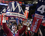 "A Delegate brandishes a big smile and a big ""W"" sign at the Republican National Convention at Madison Square Garden in New York City in August of 2004.."