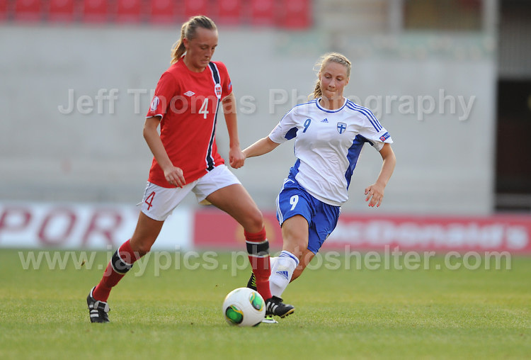 Carlotta Fennefoss of Norway battles with Juliette Kemppi of Finland during the UEFA Womens U19 Championships at Parc y Scarlets, Monday 19th August 2013. All images are the copyright of Jeff Thomas Photography-www.jaypics.photoshelter.com-07837 386244-Any use of images must be authorised by the copyright owner.