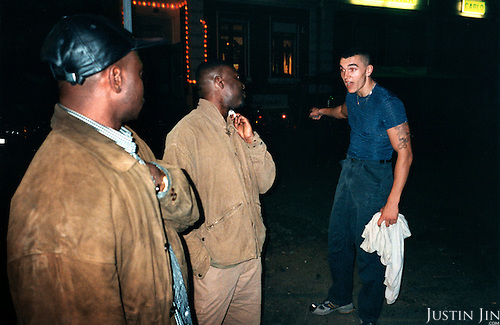 A right-wing radical approaches two Cameronians with a stone in hand while shouting racist remarks in the eastern German town of Rattinow, near Berlin in the state of Brandenburg. The 21-year-old punched the photographer in the face. Police came, arrested the photographer and set free the aggressor. ...Picture taken 2000 by Justin Jin. ..