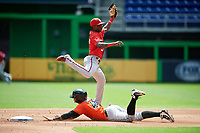 Washington Nationals Andruw Monasterio (5) receives a throw as Chris Torres (48) slides into second base during a Florida Instructional League game against the Miami Marlins on September 26, 2018 at the Marlins Park in Miami, Florida.  (Mike Janes/Four Seam Images)