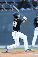 Right fielder Matt Ramsay (19) of the Wofford College Terriers bats in a game against the Boston College Eagles on Friday, February 13, 2015, at Russell C. King Field in Spartanburg, South Carolina. Wofford won, 8-4. (Tom Priddy/Four Seam Images)