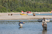 Fisherman share the Brooks River with brown bears that come to feed on the salmon, Katmai National Park, Alaska