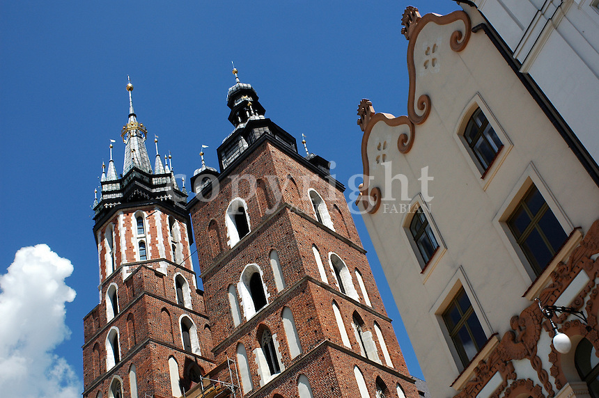 Detail of the St. Mary's church and a classic house in the main square of Cracow, Poland, Europe