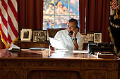 United States President Barack Obama makes Thanksgiving Day phone calls from the Oval Office of the White House in Washington, DC.  In all he phoned 10 members of U.S. armed services - two from each the Army, Air Force, Coast Guard, Marine Corps, and Navy - deployed in support of Operation New Dawn and Operation Enduring Freedom. The President thanked each of them for their service and sacrifice and wished them and their families a Happy Thanksgiving, Thursday, November 24, 2011.  The White House did not release names. .Mandatory Credit: Pete Souza - White House via CNP