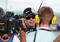Nov. 14, 2008; Homestead, FL, USA; NASCAR Sprint Cup Series driver Jimmie Johnson is interviewed during qualifying for the Ford 400 at Homestead Miami Speedway. Mandatory Credit: Mark J. Rebilas-