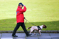 Pictured: A search police officer with a sniffer dog in St Helen's Road, Swansea. Friday 15 September 2017<br /> Re: Soldiers from the Welsh Guards have exercised their freedom to march through the streets of Swansea in Wales, UK.<br /> The Welsh warriors paraded with bayonets-fixed from the city centre to the Brangwyn Hall, where the Lord Mayor of Swansea took a salute.