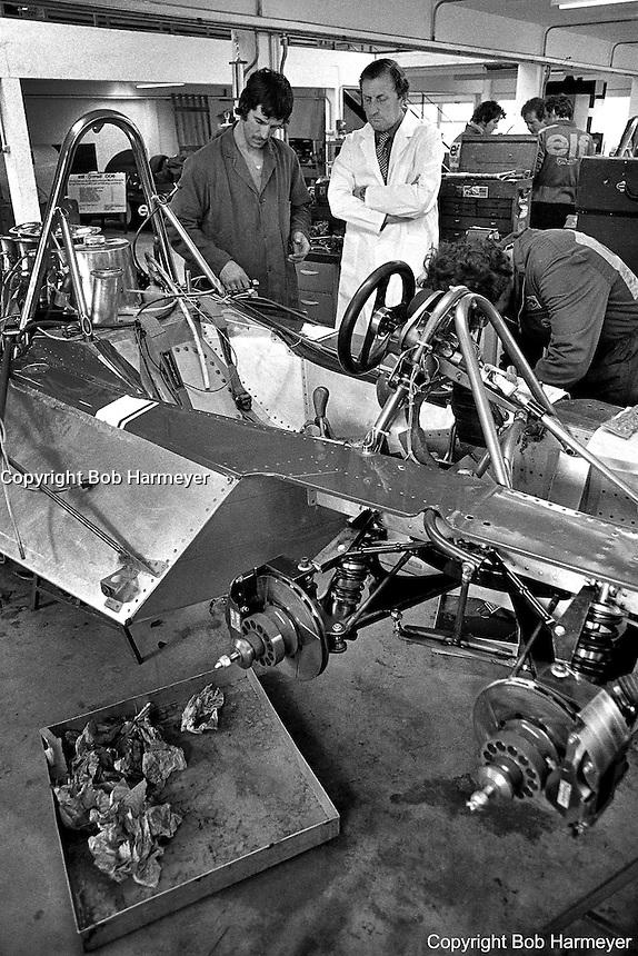 OCKHAM, SURREY - MAY, 1976: Derek Gardner, designer of the Tyrrell P34 six-wheel Formula 1 car, discusses the car with a crew member at the Tyrrell Racing Organization headquarters in Ockham, Surrey, United Kingdom.