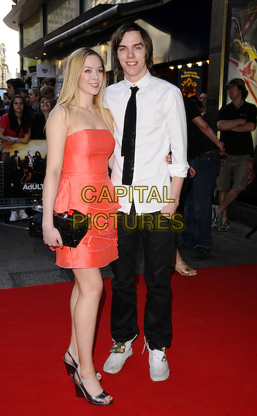 "ROSANNA HOULT & NICHOLAS HOULT.World Premiere of ""Adulthood"" held at the Empire Leicester Square, London, England, UK, .June 17th 2008 .arrivals full length red strapless dress black tie white shirt clutch bag pink .CAP/CAN.©Can Nguyen/Capital Pictures."