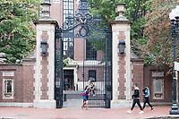 People walk past one of the gates from Massachusetts Avenue into Harvard Yard is seen at Harvard University in Cambridge, Massachusetts, USA, on Mon., Oct 15, 2018.
