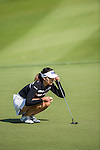In-Gee Chun of Korea lines up a putt during the Hyundai China Ladies Open 2014 at World Cup Course in Mission Hills Shenzhen on December 14 2014, in Shenzhen, China. Photo by Li Man Yuen / Power Sport Images