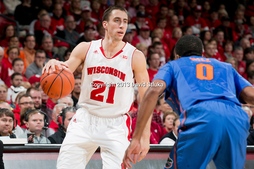 Wisconsin Badgers guard Josh Gasser (21) handles the ball during an NCAA college basketball game against the Florida Gators Tuesday, November 12, 2013, in Madison, Wis. The Badgers won 59-53. (Photo by David Stluka)