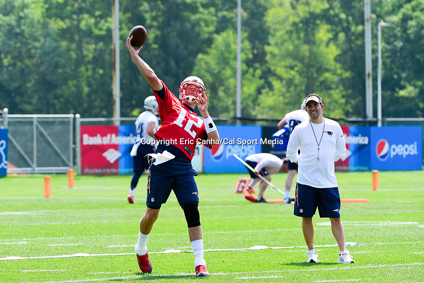 June 13, 2017: New England Patriots quarterback Tom Brady (12) throws a pass as offensive coordinator Josh McDaniels watches at the New England Patriots organized team activity held on the practice field at Gillette Stadium, in Foxborough, Massachusetts. Eric Canha/CSM