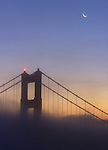 Sun rise turns the fog enveloping the Golden Gate Bridge into a multi-colored blanket. A late-morning solar eclipse on Christmas Day will obscure almost half of the sun's diameter.