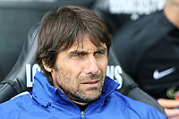 Chelsea manager Antonio Conte sits on his seat during the Premier League game between Swansea City v Chelsea at the Liberty Stadium, Swansea, Wales, UK. Saturday 28 April 2018