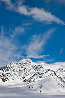 Clouds swirl over the ruth glacier and Alaska Range mountains, Denali National Park, Alaska.