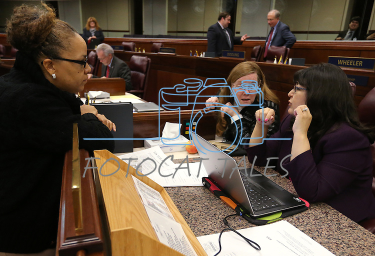 Assembly Democrats, from left, Dina Neal, Maggie Carlton and Irene Bustamante Adams work at the Legislative Building in Carson City, Nev., on Wednesday, Dec. 16, 2015. Gov. Brian Sandoval called lawmakers into a special session Wednesday to consider a package of tax incentives to bring the startup electric car manufacturer Faraday Future to Southern Nevada. (Cathleen Allison/Las Vegas Review-Journal)