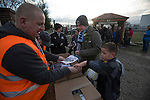 A home supporter buying a programme inside the ground before the Boxing Day derby match between Runcorn Town and visitors Runcorn Linnets at the Pavilions, Runcorn, in a top-of the table North West Counties League premier division match. Runcorn Linnets won 1-0 and overtook their neighbours at the top of the league in a game watched by 803 spectators. Runcorn Linnets were a successor club to Runcorn FC, one of England foremost non-League clubs of the 1970s and 1980s.