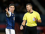 Scott Brown of Scotland rates a point with referee Sveinn Oddvar Moen during the Vauxhall International Challenge Match match at Hampden Park Stadium. Photo credit should read: Simon Bellis/Sportimage