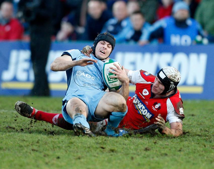 Photo: Richard Lane/Richard Lane Photography. Gloucester Rugby v Cardiff Blues. Heineken Cup. 18/01/2009. Cardiff's Leigh Halfpenny is tackled by Gloucester's Alasdair Strokosch.