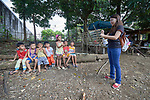 Deaconess Maria Jessica Cicillo teaches the hand motions that go with a song to children in Mt. Heights, Philippines, where she works as a Christian educator for a nearby United Methodist Church. She is a graduate of Harris Memorial College.
