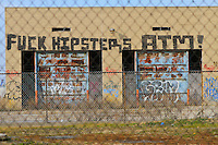 Anti hipster graffiti in Detroit's Industrial Area
