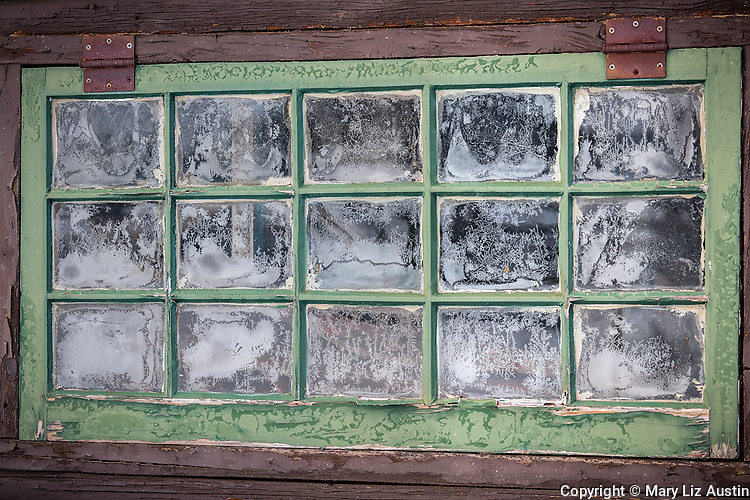 Yellowstone National Park, WY: Frosted glass panes of barn window at Lamar Buffalo Ranch in Lamar Valley.