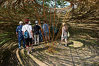 NWA Democrat-Gazette/ANDY SHUPE<br /> Visitors check out a bird blind constructed by Fayetteville artist Stuart Fulbright Saturday, Sept. 7, 2019, during a tour of the Wilson Springs Preserve in Fayetteville. The Northwest Arkansas Land Trust has been working for seven years to preserve and restore the 121-acre prairie wetland and opened the area to visitors with Immerse, a nature and arts festival.