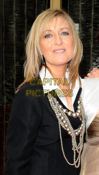 FIONA PHILLIPS.Tesco Mum of the Year Awards at the Waldorf Hilton Hotel, London, England, March 1st 2009.half length black blazer suit jacket beads pearl necklace white shirt necklaces .CAP/CAN.©Can Nguyen/Capital Pictures