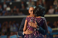 September 6, 2012  (Charlotte, North Carolina) President Barack Obama and first lady Michelle Obama embrace on the last night of the 2012 Democratic National Convention in Charlotte.   (Photo by Don Baxter/Media Images International)