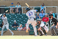 Surprise Saguaros first baseman Yanio Perez (47), of the Texas Rangers organization, at bat in front of catcher Dom Miroglio (55) and home plate umpire Blake Carnahan during an Arizona Fall League game against the Salt River Rafters at Salt River Fields at Talking Stick on October 23, 2018 in Scottsdale, Arizona. Salt River defeated Surprise 7-5 . (Zachary Lucy/Four Seam Images)