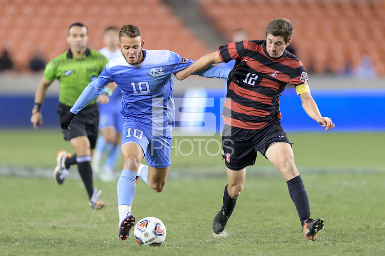 Houston, TX -  Friday, December 9, 2016: Zach Wright (10) of the North Carolina Tar Heels battles for the ball in the first half with Drew Skundrich (12) of the Stanford Cardinal   at the  NCAA Men's Soccer Semifinals at BBVA Compass Stadium.