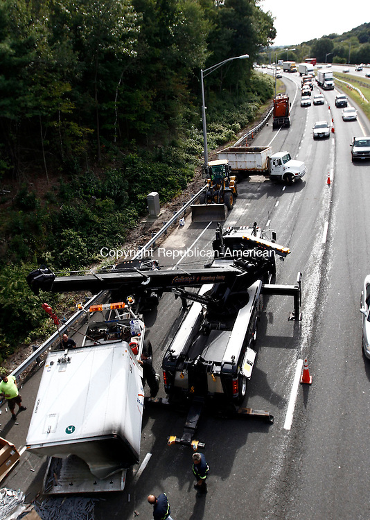 Waterbury, CT- 09 September 2013-090913CM02-  Traffic slows as crews load the part of a tractor trailer onto a truck off I-84 in Waterbury Monday afternoon.  The tractor trailer rolled over before exit 19 on the eastbound lane of I84. Christopher Massa Republican-American