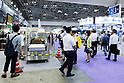 Visitors gather at the FOOMA Japan International Food Machinery and Technology Exhibition at Tokyo Big Sight on June 11, 2015, Tokyo, Japan. More than 200 companies showed off the latest technology for the food processing industry. The exhibition is held from June 9 to 12. (Photo by Rodrigo Reyes Marin/AFLO)
