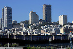 SAN FRANCISCO HI-RISE APARTMENT BUILDINGS on HILLSIDE and LOWER LEVEL BUILDINGS BELOW. WALKING BRIDGE in FOREGROUND