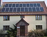 Solar panels on roof of old cottage, Yoxford, Suffolk, England