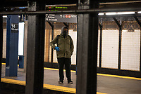 NEW YORK, NY - MARCH 19: Passengers wearing a  masks travel on a subway train in New York City on March 19, 2020. The ridership declined 90 percent compared to the same date last year due to the Coronavirus. The World Health Organization declared a global pandemic as the coronavirus rapidly spreads across the world. (Photo by Joana Toro/ VIEWpress via Getty Images)