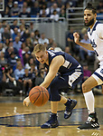 Utah State guard Sam Merrill (5) can't get the lose ball against Nevada in the second half of an NCAA college basketball game in Reno, Nev., Wednesday, Jan. 2, 2019. (AP Photo/Tom R. Smedes)