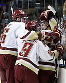 Patrick Wey (BC - 6), Barry Almeida (BC - 9) and Philip Samuelsson (BC - 5) celebrate Samuelsson's goal. - The Boston College Eagles defeated the Boston University Terriers 3-2 (OT) in their Beanpot opener on Monday, February 7, 2011, at TD Garden in Boston, Massachusetts.
